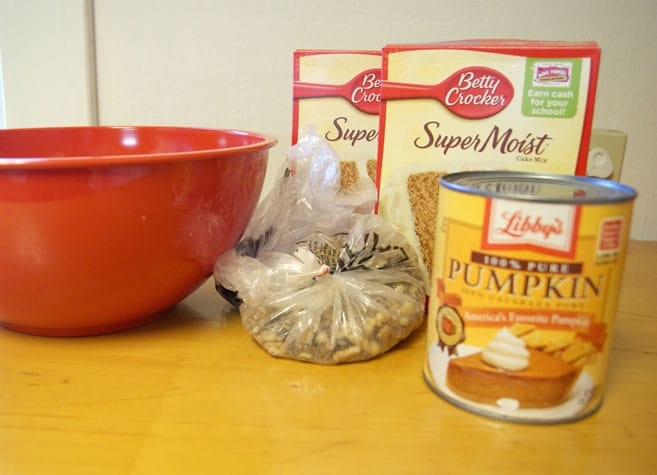 a can of pumpkin, cake mix, nuts and a red bowl