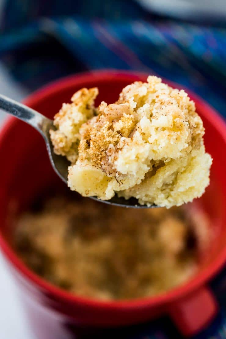 A spoonful of Coffee Cake made in a mug with struesel topping