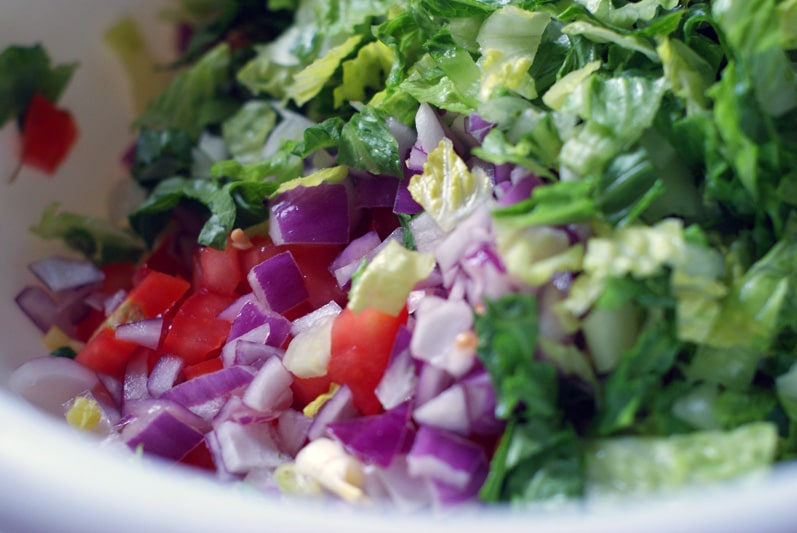 Simple BBQ Chicken Chopped Salad ingredients in a large white bowl.