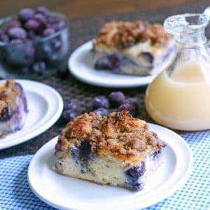 blueberry french toast casserole on white plate with blue check napkin