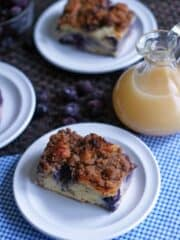 blueberry french toast casserole on white plate with blue check napkin under