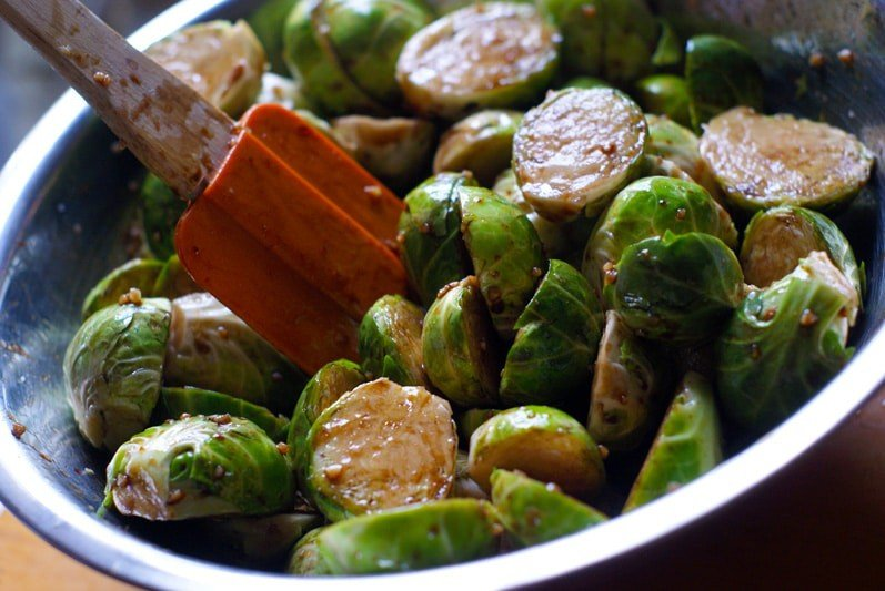 bowl of brussels sprouts in bowl mixed with sauce