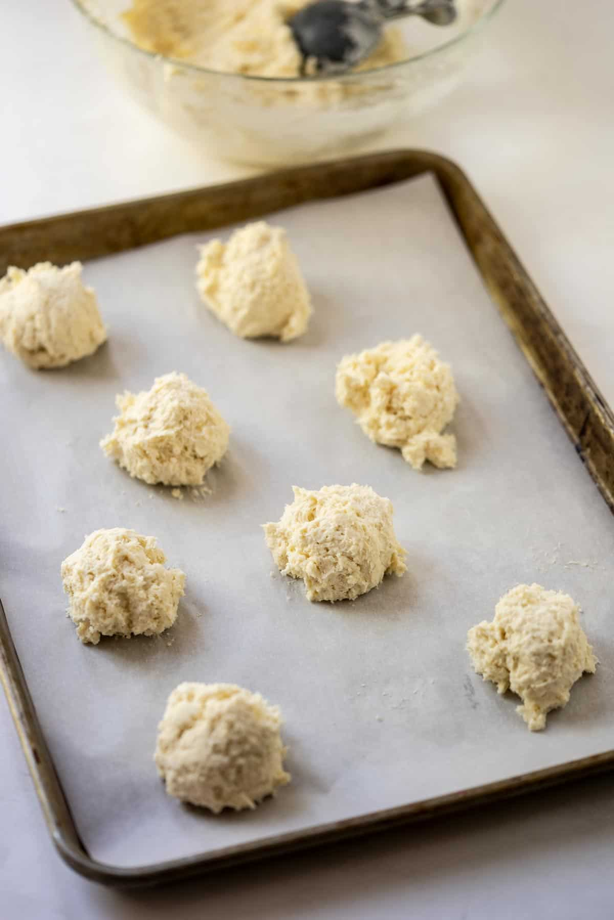 Drop biscuit dough on a baking sheet