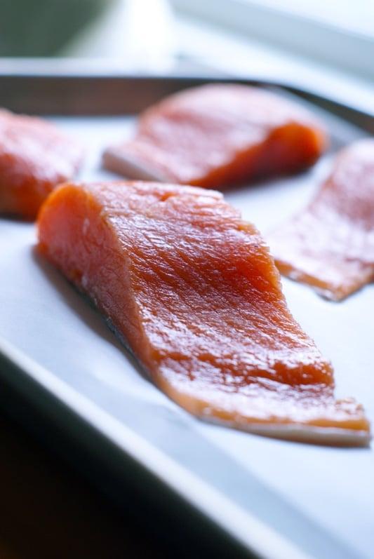 raw salmon filets on a baking sheet