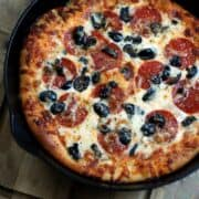 baked deep dish pizza in a cast iron pan