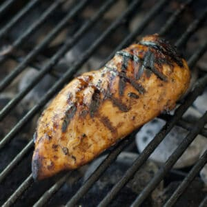 Grilled chicken breast on the grill