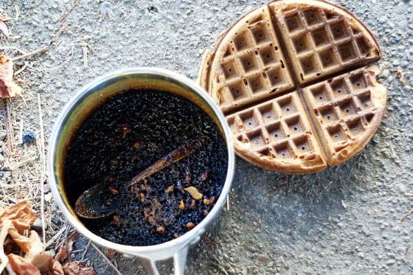 burnt pecan sauce in a pot with a burnt waffle beside it