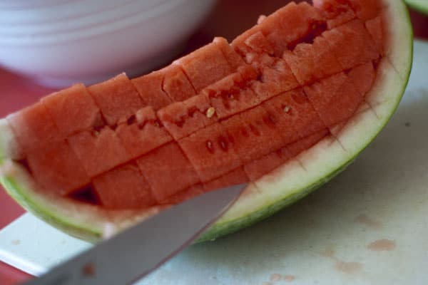 Loosening watermelon slices out of watermelon slice.