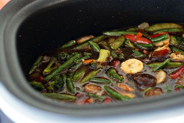 veggies in pan with chili sauce