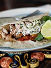 Broiled Fish Tacos with Tangy Slaw on a blue and white plate