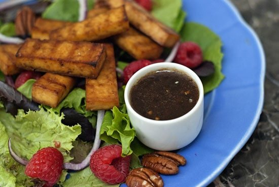 Homemade Raspberry and Balsamic salad in a large blue plate on a table.