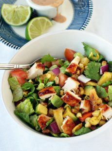 Simple BBQ Chicken Chopped Salad recipe in a large white bowl with a silver fork.