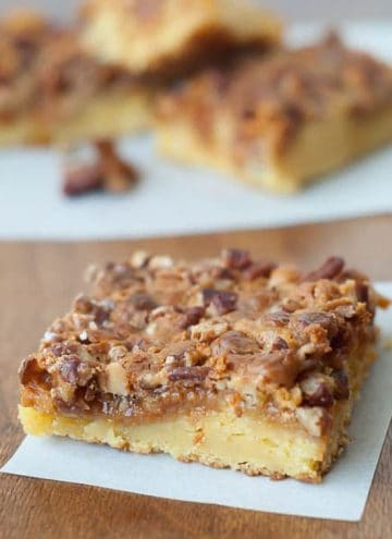 Simple Hornet's Nest Cake with butterscotch and pecans on a wooden table.