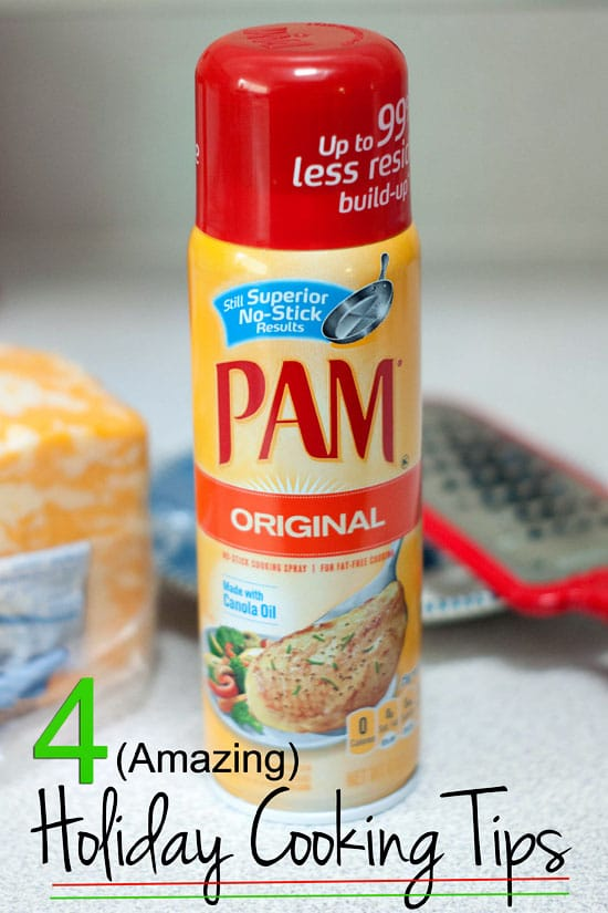 Original PAM Cooking Spray on a table next to a cheese shredder and a brick of colby jack cheese.