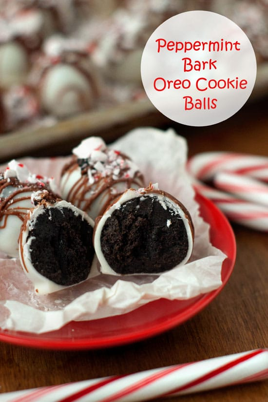 Peppermint Bark Oreo Cookie Balls cut in half on a red plate on a wooden table.