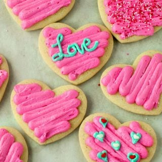 Valentine's Day sour cream sugar cookies with pink icing on a table.