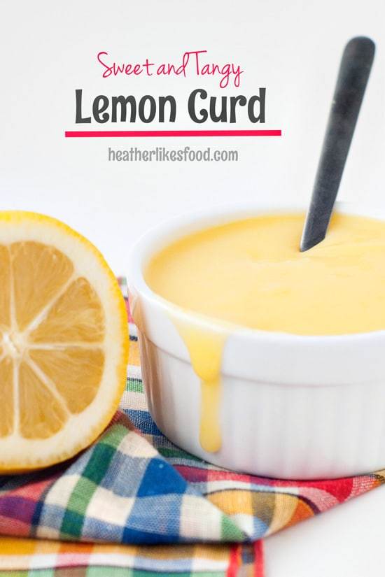 Sweet Lemon Curd in a small white bowl with a metal spoon and a slice of lemon.