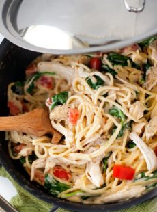 Delicious Chicken Florentine noodles with fresh tomatoes and spinach a large skillet.