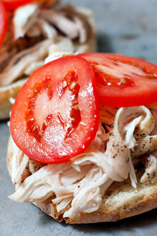 Easy Kentucky Hot Brown with fresh tomatoes and shredded chicken.
