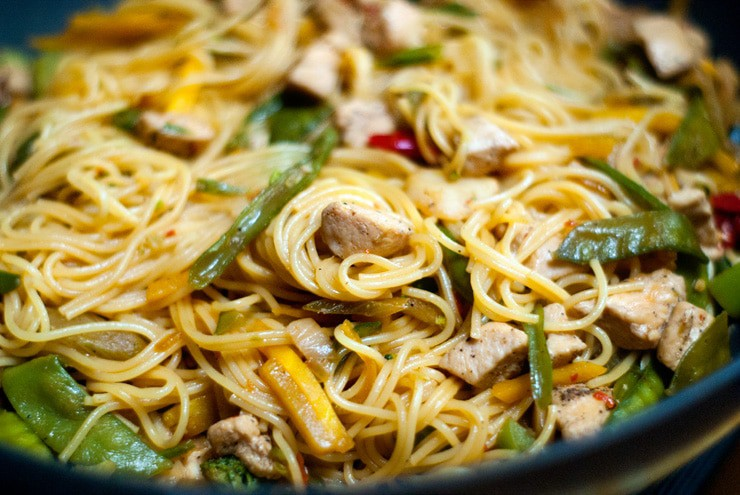 Easy Chicken Lo Mein stir fry in a large black skillet.