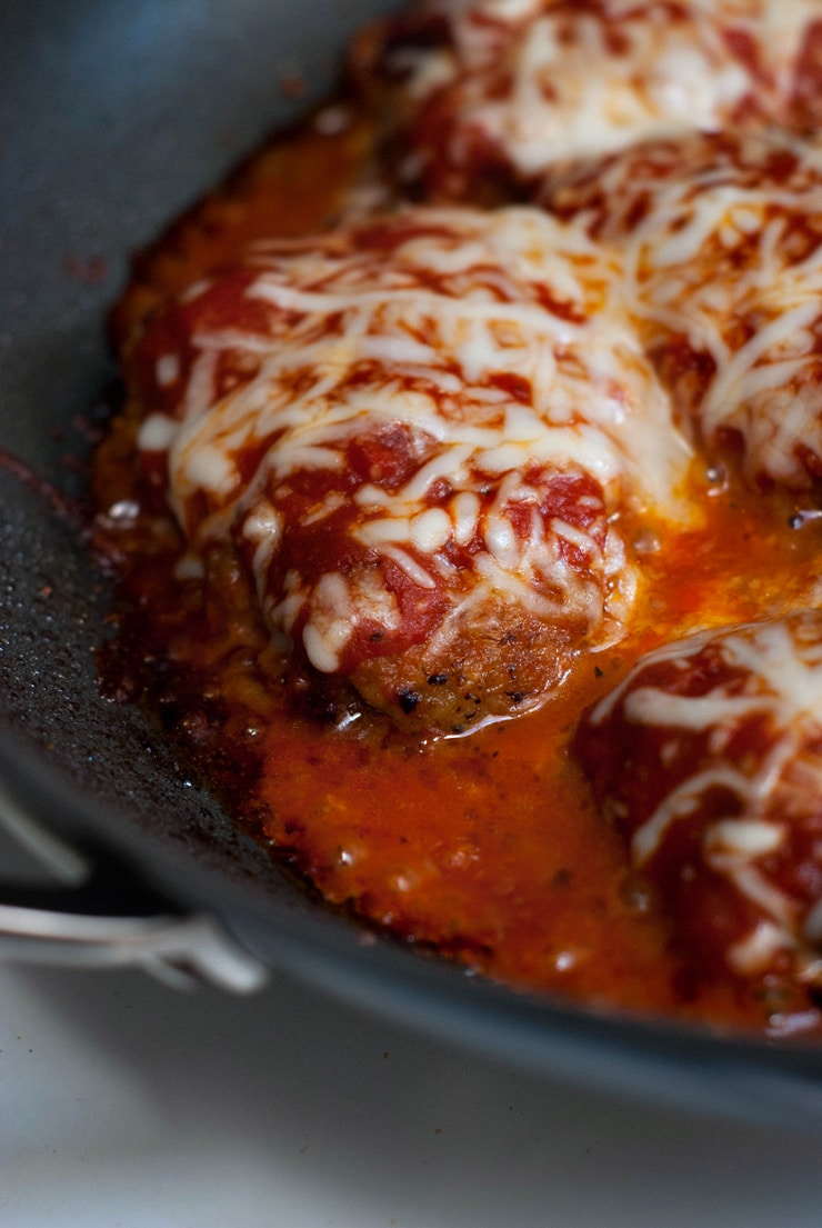 delicious Beef Parmesan recipe in a black skillet.
