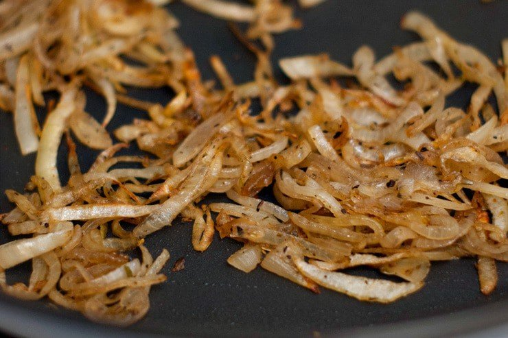Delicious Caramelized Onions in a cooking skillet.