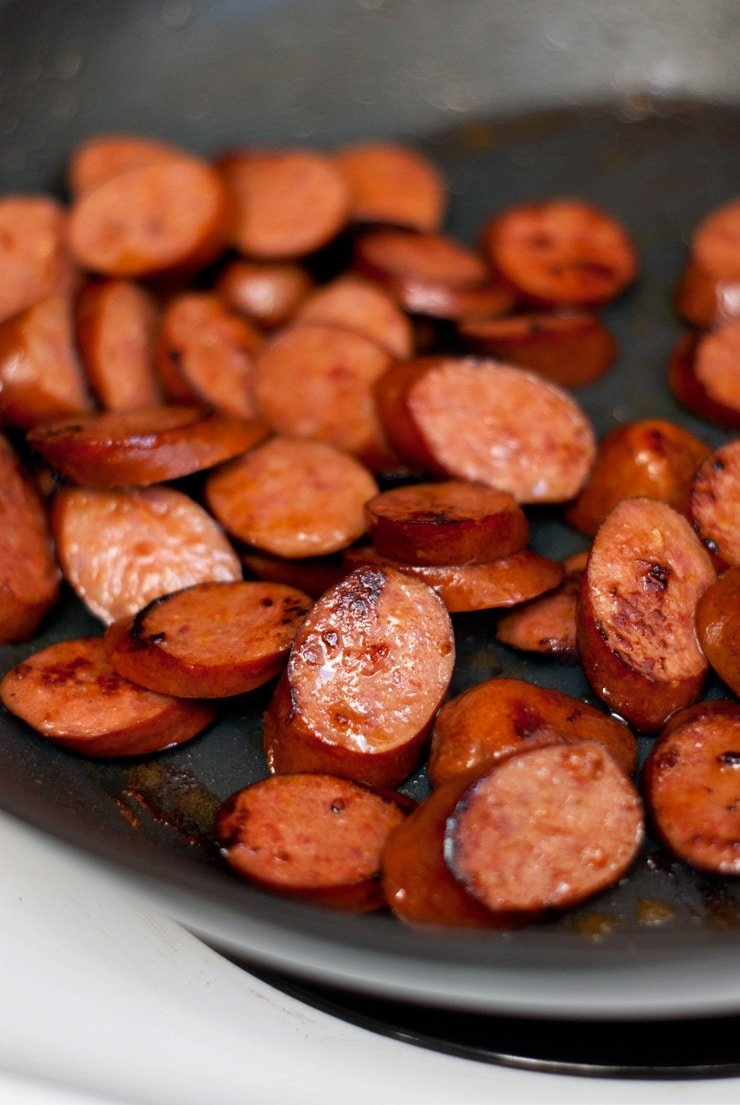 Smoked Sausage in a silver skillet.