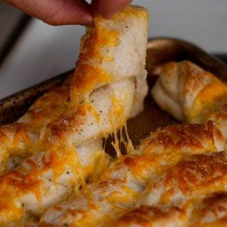Soft and Cheesy Garlic Breadsticks | heatherlikesfood.com