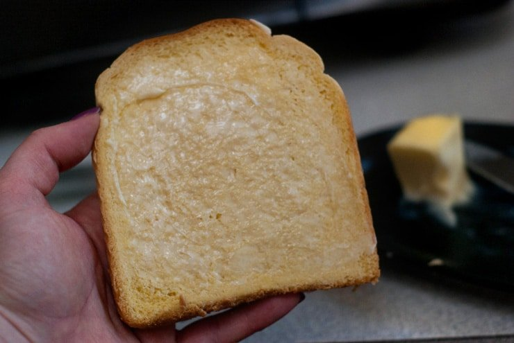 Holding Buttered Bread.