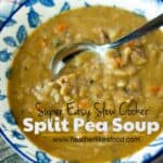 Delicious Slow Cooker Split Pea Soup in a white and blue bowl with a silver spoon on a wooden table.