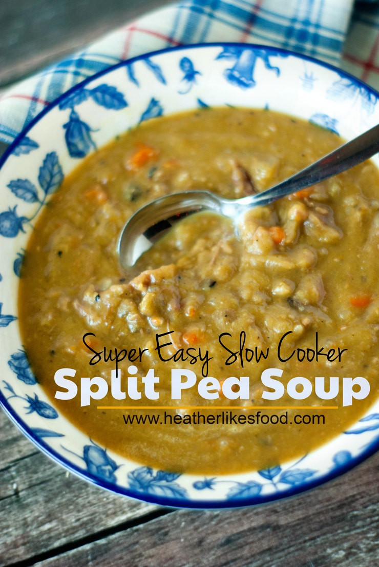 Scooping Super Easy Slow Cooker Split Pea Soup out of a blue and white serving bowl on a wooden table.