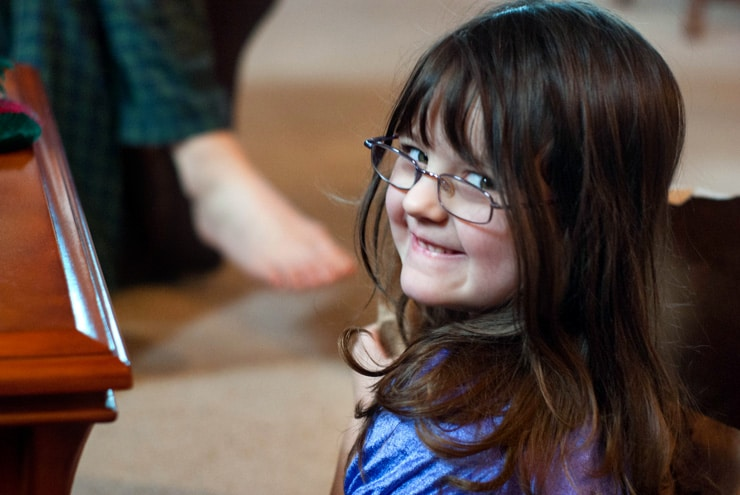Little girl with glasses.