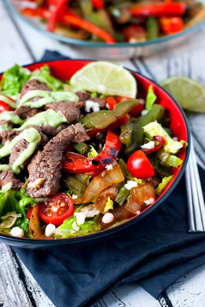 Skillet Steak Fajita Salad in Red Bowl with fork