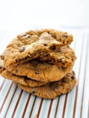 Big Chewy Chocolate Chip Cookies just like you get at the bakery. Crisp around the edges, soft in the middle and filled with chocolate, these cookies are spectacular-- espcially with a big glass of milk! The secret is in letting the dough sit in the fridge overnight to let the flavor develop and become rich and buttery. Find more excellent recipes at Heather Likes Food .com!