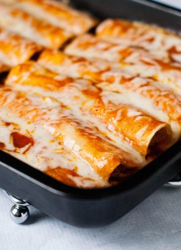 Taco Chicken Enchiladas: Throw some chicken in the slow cooker with some taco seasoning, cook, shred, and roll up in corn tortillas. Top with enchilada sauce and monterrey jack cheese . Makes enchiladas everyone loves!