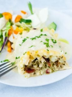 Skinny Chicken Bacon and Pesto Lasagna Roll-Ups. These taste much more naughty than they actually are and are a total crowd pleaser every time I make them!