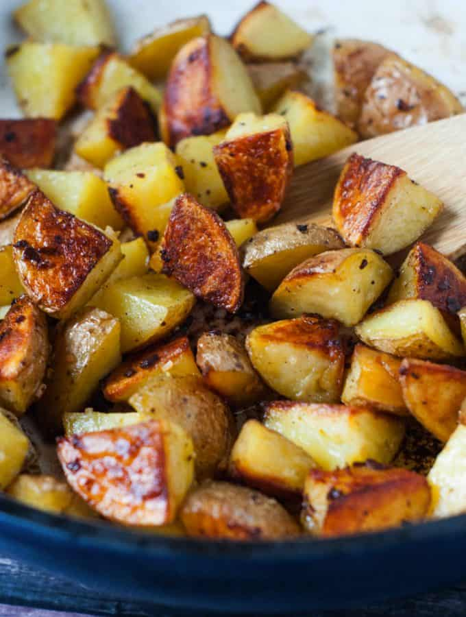 These Super Crispy Oven Roasted Garlic Potatoes are what my dreams are made of. They are made quick and easy in the oven and take just a few minutes to throw together, making them a perfectly quick side for dinner!