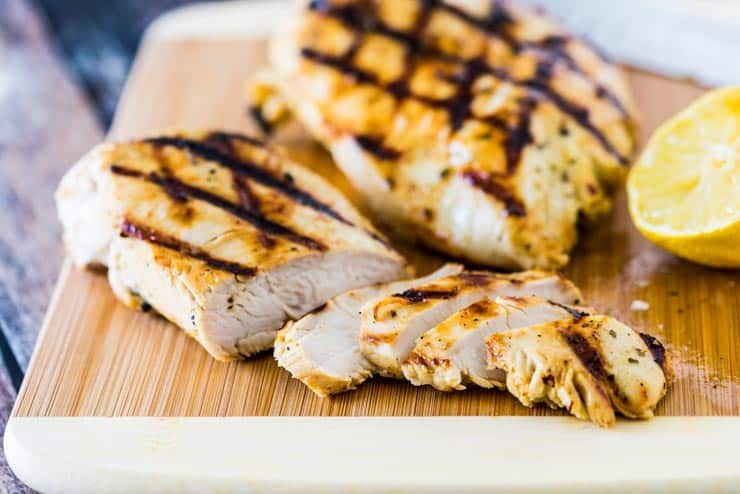 Grilled Garlic Ranch Chicken made with a quick chicken marinade on a cutting board