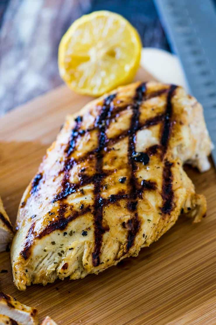 Garlic Ranch Chicken Marinade recipe-- grilled chicken on a cutting board
