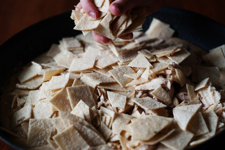 Cut tortillas for sour cream enchiladas skillet