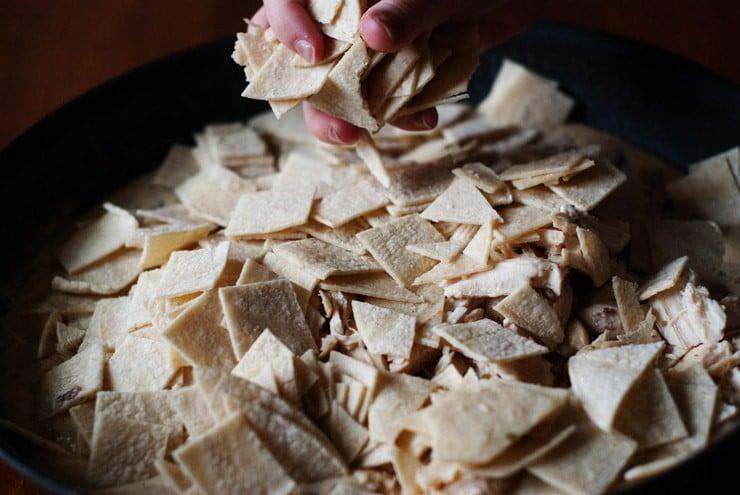 Cut tortillas for sour cream enchiladas skillet