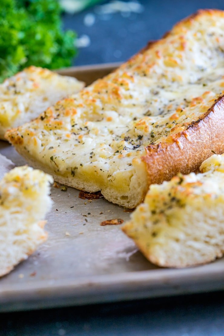 The Best Cheesy Garlic Bread! You might shirk at one of the ingredients, but believe me, you're going to want to try this one! Buttery, tangy, garlicky, and so, so cheesy. THE BEST!