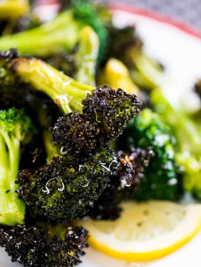 Ready for the most incredible roasted broccoli and easiest dinner of your life? This broccoli lives up to it's name and the chicken is so easy to make! Dinner will be done in under an hour with very little prep and you'll have many happy tummies around your dinner table! ** Post Sponsored by Barber Foods