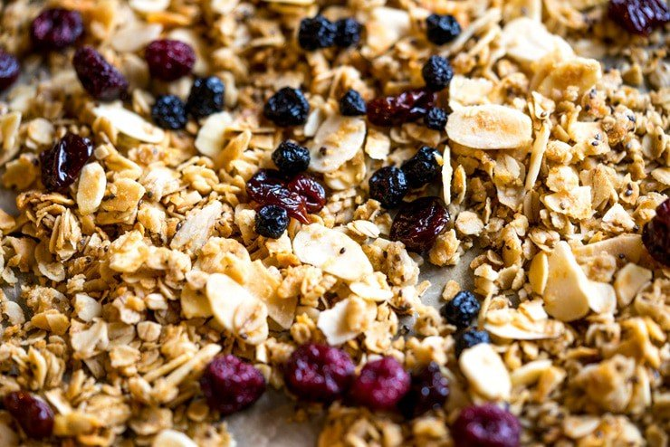 This sweet, salty, crunchy, and chewy coconut oil granola is the perfect breakfast to keep you going strong through the holidays. It's filled with big flakes of unsweetened coconut flakes, oats, whole wheat flour, chia seeds, almonds and studded with sweet dried berries. #GracelandHoliday AD