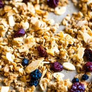 This sweet, salty, crunchy, and chewy coconut oil granola is the perfect breakfast to keep you going strong through the holidays. It's filled with big flakes of unsweetened coconut, oat, whole wheat flour, chia seeds and almonds.