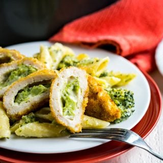 Cheesy Broccoli Pasta and Chicken-- Cheesy pasta, filled with broccoli and topped with crispy stuffed chicken! The pasta comes together in one pan and the chicken goes from the freezer to the table in 35! Made in Partnership with @BarberFoods. #BarberNight