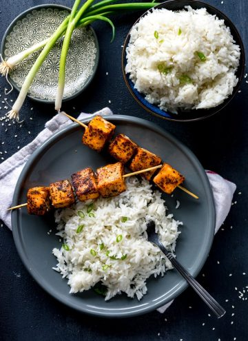 You're going to love these spicy and Sweet Sriracha Rubbed Salmon Skewers, especially paired with some crazy good fragrant coconut rice. It's a meal that is done in well under 30 minutes but delivers some seriously big flavor.