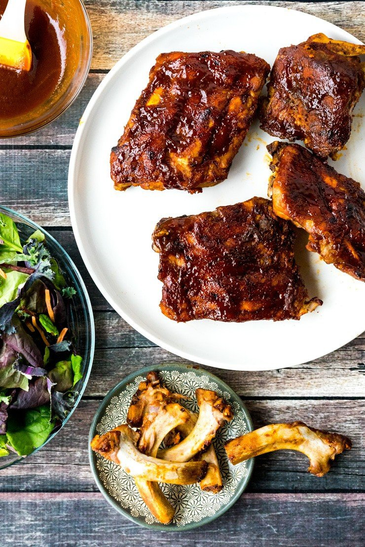 Instant Pot BBQ Babyback Ribs with sauce on a white plate