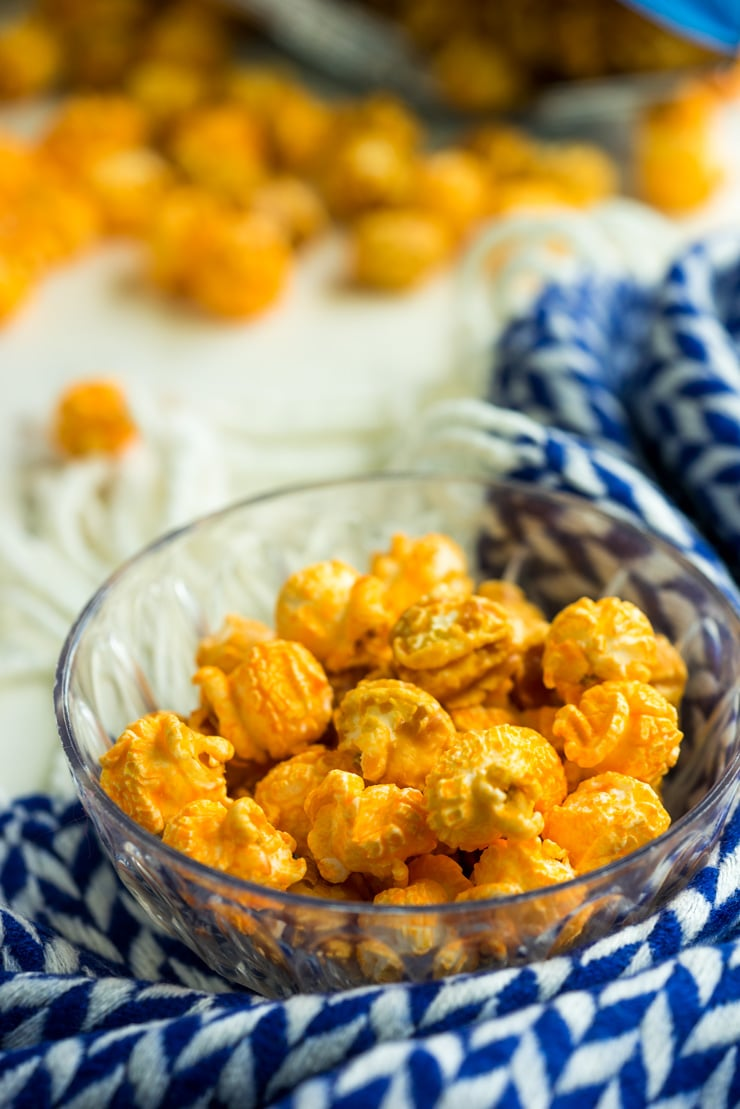 You may be a skeptic, but cheese popcorn is MEANT for ice cream popcorn sundaes! Especially when paired with the best homemade hot fudge and homemade caramel sauce! It's sweet n' salty goodness, friends!
