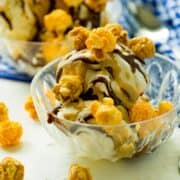 You may be a skeptic, but cheese popcorn is MEANT for ice cream sundaes! Especially when paired with the best homemade hot fudge and homemade caramel sauce! It's sweet n' salty goodness, friends!